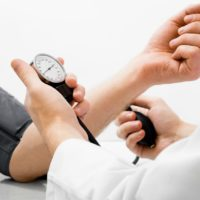Patient and doctor taking high blood pressure
