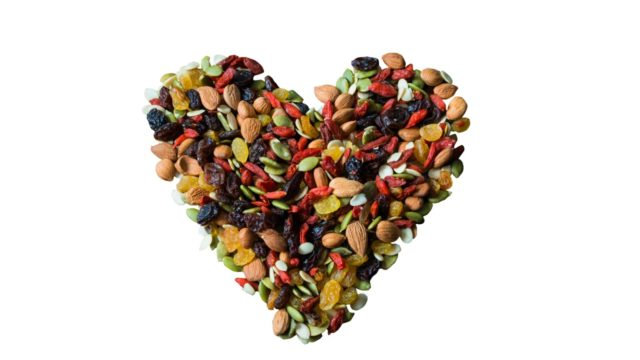 Trail mix in a heart shape with a white background