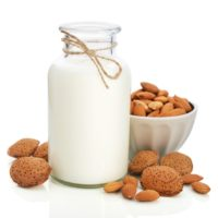 Almond milk in mason jar with nuts isolated on white background