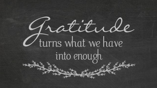 Gratitude turns what we have into enough on a chalk board